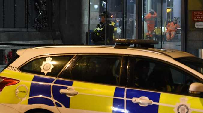 Police officers stand guard outside Manchester Victoria Station after three people, including a police officer, were attacked by a knife wielding man screaming 'Allah'. Picture: Paul Ellis/AFP