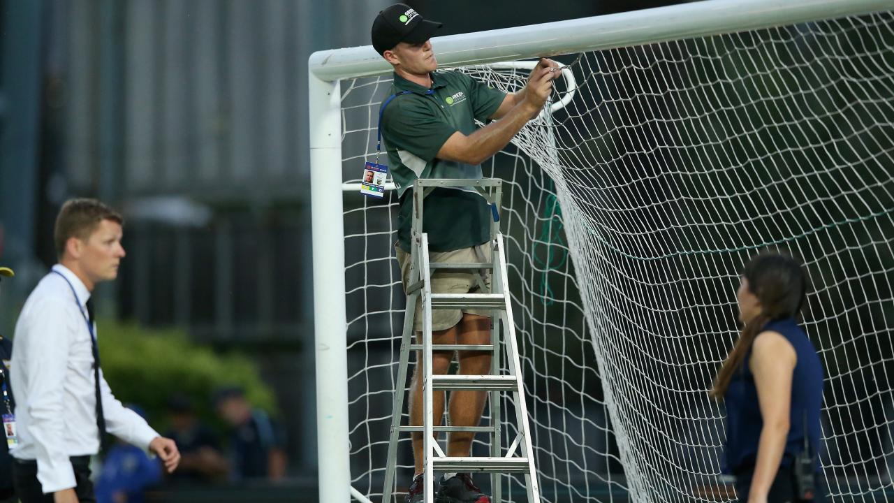 Groundsmen tend to urgent repairs after the goalpost snapped.