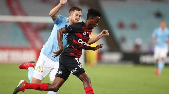 Western Sydney Wanderers attacker Bruce Kamau tries to get past Melbourne City defender Scott Jamieson on Monday night. Picture: Getty Images