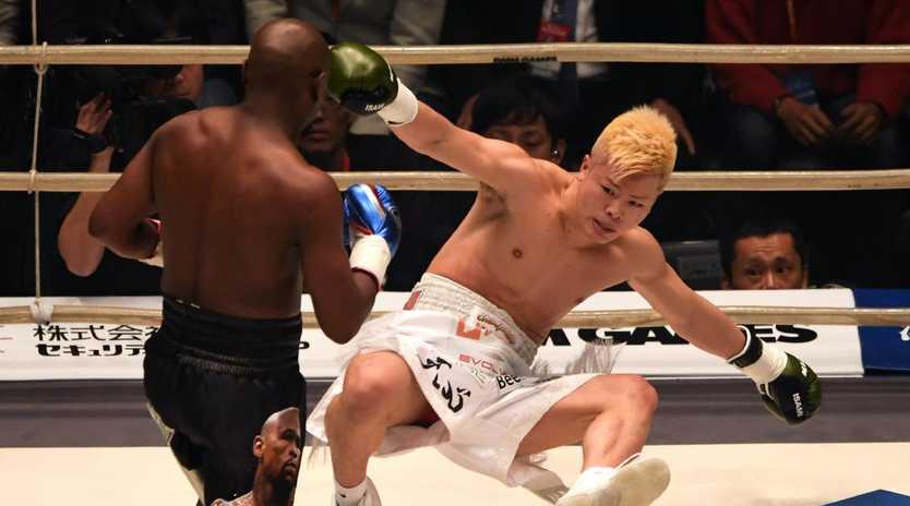 Floyd Mayweather Jr knocks down kickboxer Tenshin Nasukawa. Picture: Toshifumi KITAMURA/AFP