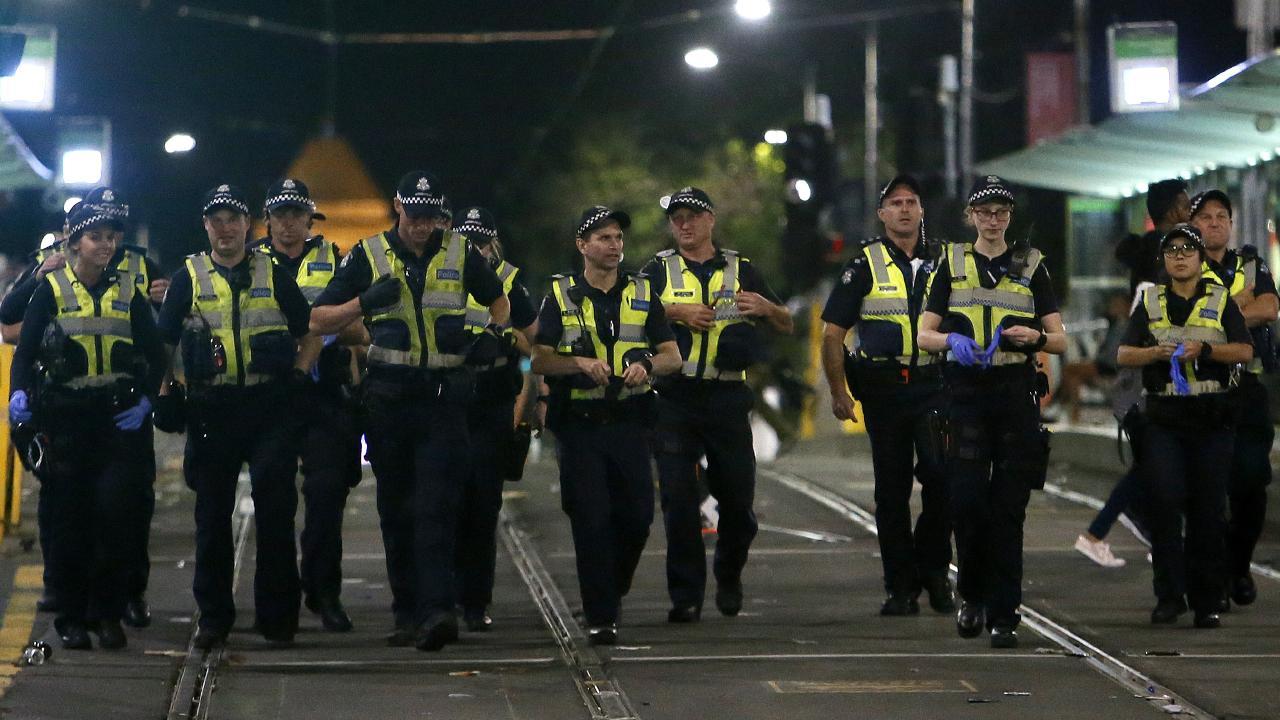 Police on corner Flinders St and Swanston St last night. Picture: Yuri Kouzmin