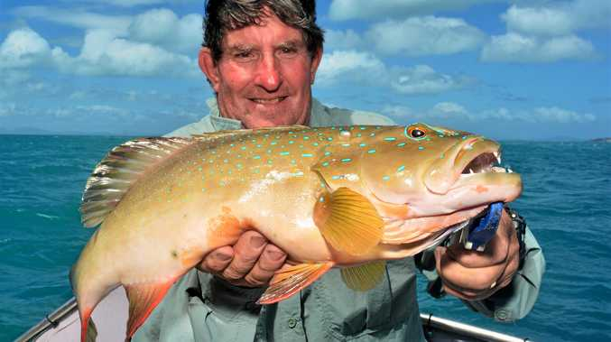 GREAT CATCH: David Muller with one of many good coral trout that have been coming aboard recently.