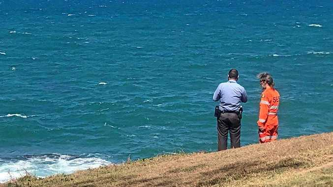 Police and SES volunteers searching the coastline at Elliott Heads, looking for more suspicious packages that may have washed up.