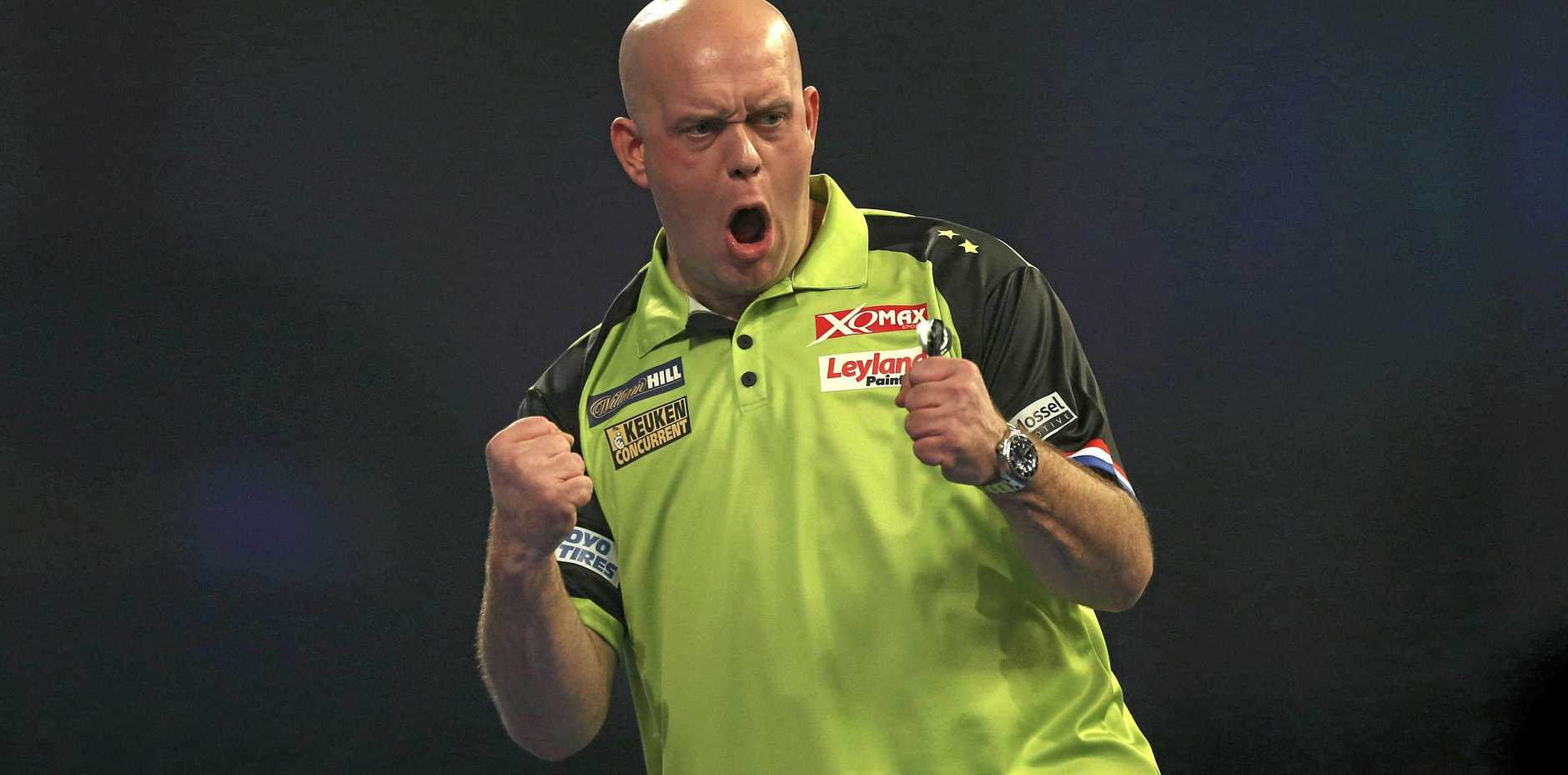 Michael Van Gerwen gets pumped up during a key moment of his match with Michael Smith for the world darts championship. Picture: Steven Paston/AP