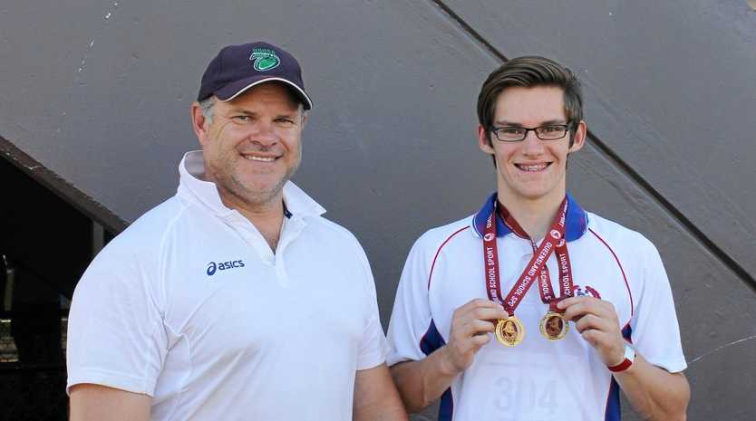 THAT'S GOLD: Toowoomba's Mason Hughes (right) celebrates school state title success with coach Justin Anlezark. Anlezark has high praise for Sports Darling Downs and the group's passion for advancing sport in the region.