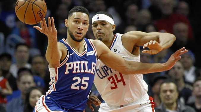 Philadelphia 76ers guard Ben Simmons loses the ball as Los Angeles Clippers forward Tobias Harris closes in. Picture: Alex Gallardo/AP