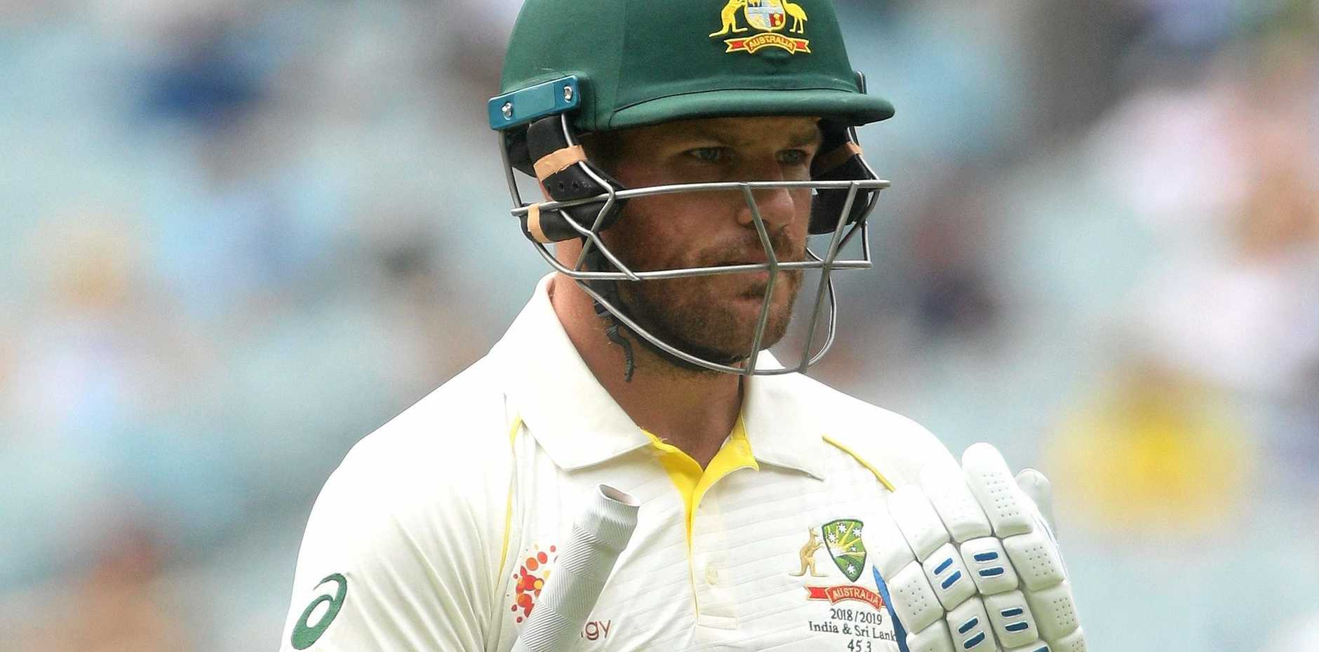 OUT: A dejected Aaron Finch leaves the field after being dismissed at the MCG against India.
