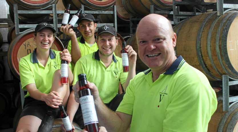 RESCUED: Whitney Shcoenfish, Dr Michael Sweedman, Michael Britten and Ian Herderson from Australian Vinegar have produced a variety of vinegar made from dumped strawberries.