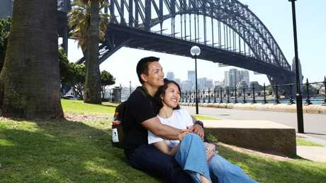 Chinese tourists Tom Lu and Lincy Cen soaking up the sun in Sydney. John Feder