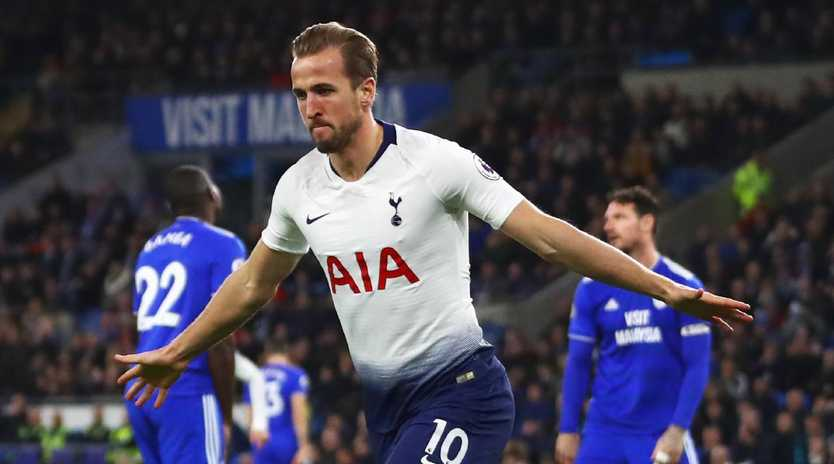 Harry Kane guided Tottenham to victory over Cardiff.
