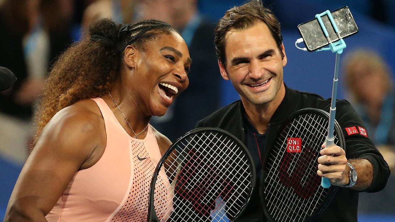 Serena Williams and Roger Federer do the selfie thing after their on-court battle.