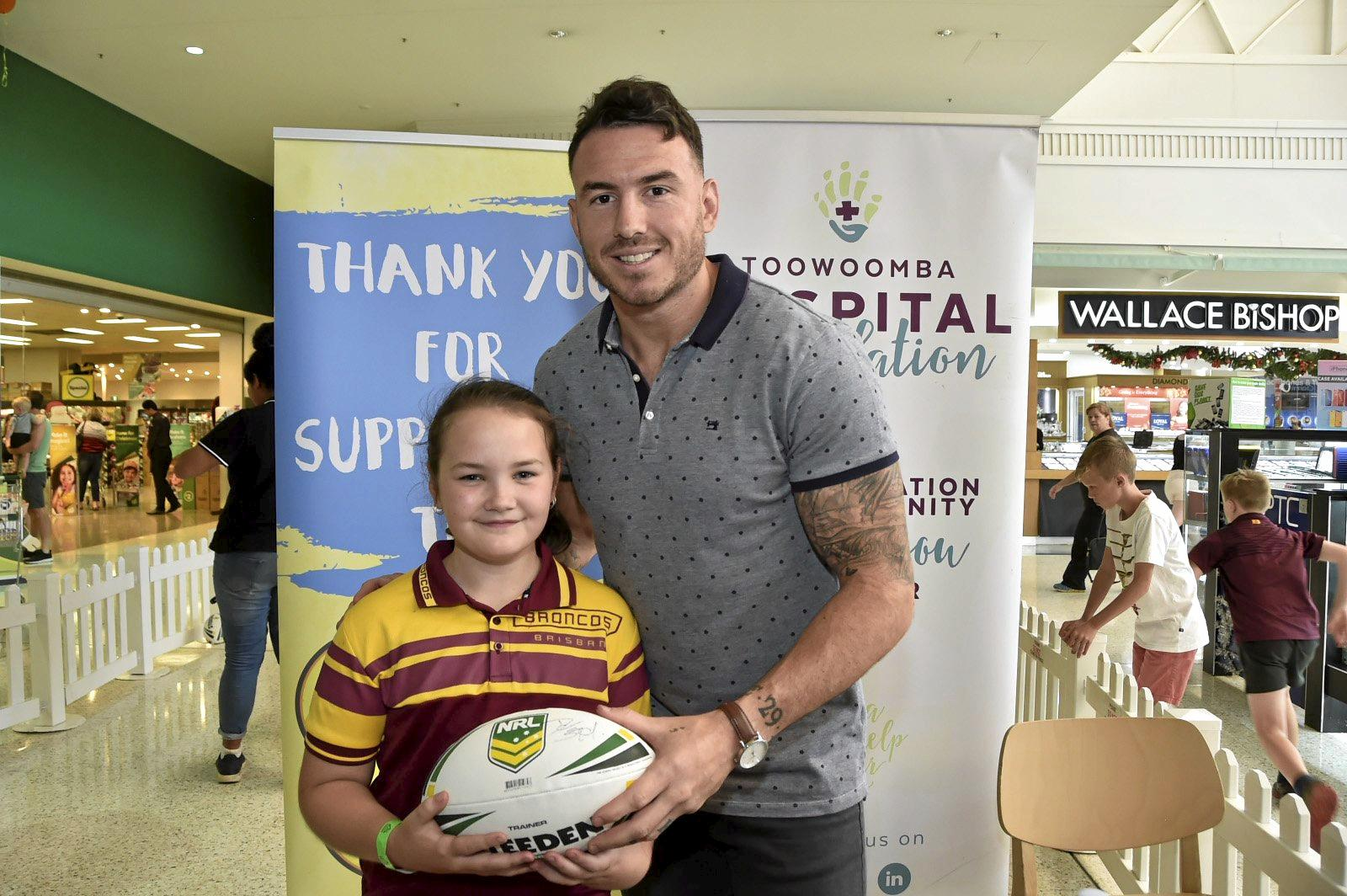 Charlotte Murphy. Broncos league player, Darius Boyd at Clifford Gardens as part of fundraising for annual Toowoomba Hospital Appeal. November 2018
