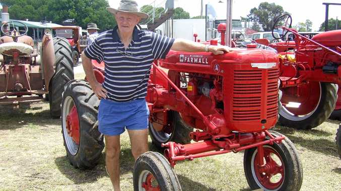 TIME WARP: Allora resident Greg Patterson looking over a restored Farmall tractor at a past Allora Heritage Weekend. It's all happening again this year on January 26 and 27 at the Allora Showgrounds.
