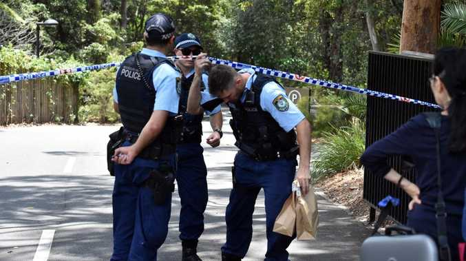 Police holding evidence bags at the scene of an alleged double stabbing at the Church of Scientology headquarters. Picture: Mick Tsikas/AAP