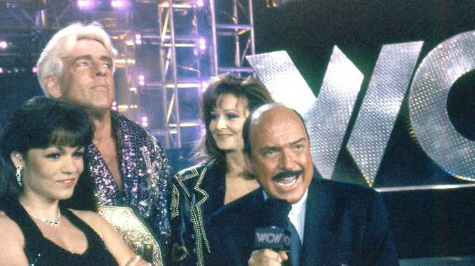 Gene Okerlund, right, during a WCW broadcast in 1998.