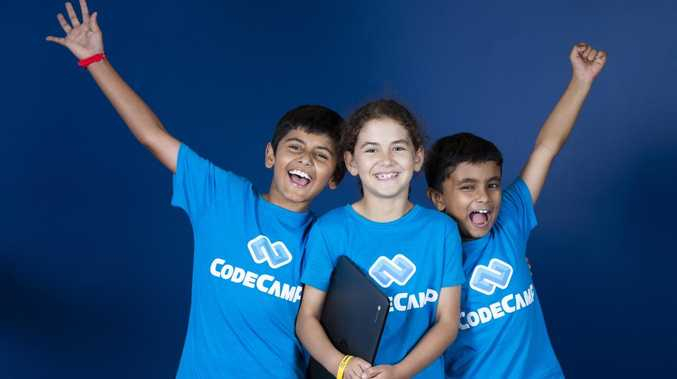 Code Camp has kept this trio from St Peters College, Springfield busy: Dahlair Nagra, Julia Bordin and Advay Deo. Picture: AAP/Renae Droop