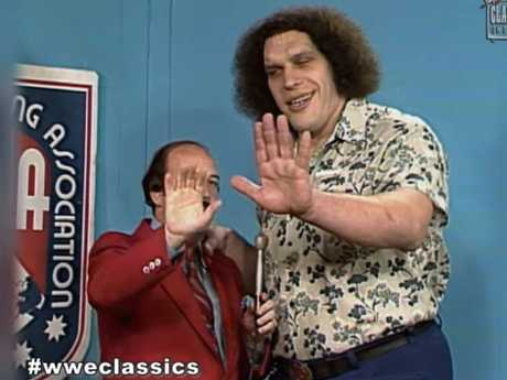 Gene Okerlund and Andre the Giant.