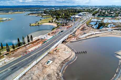 A number of milestones are within reach at Stockland's Oceanside development in Birtinya. Pictured are recent aerial photographs showing housing site and lake development in the Bokarina Beach residential area.