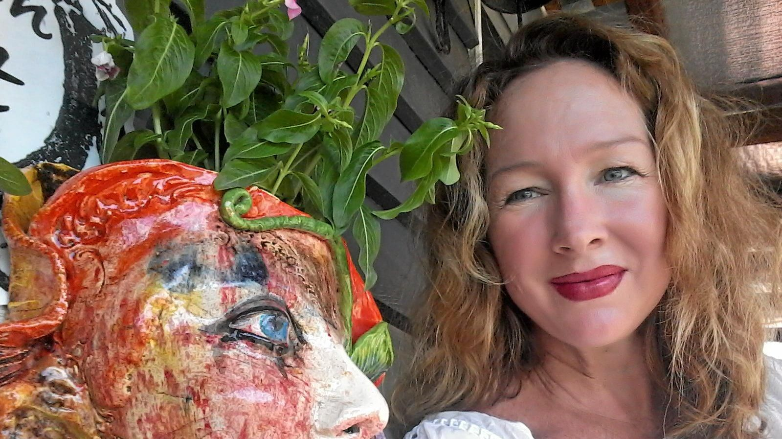 Alicia Murphy with one of her self-portrait lady masks.