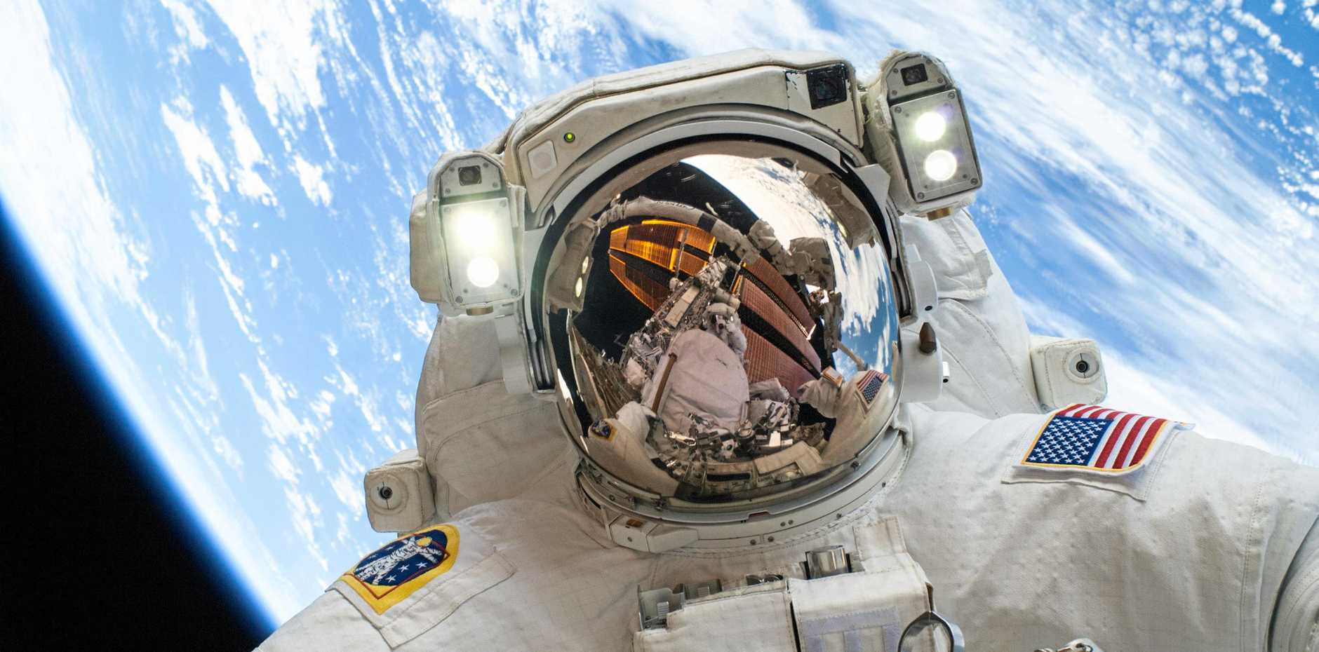 NASA astronaut Mike Hopkins, Expedition 38 flight engineer, participates in the second of the two spacewalks of the mission on December 24, 2013, spread over a four day period, which were designed to allow the crew to change out a faulty water pump on the exterior of the Earth orbiting International Space Station. He was joined on both spacewalks by NASA astronaut Rick Mastracchio, whose image shows up in Hopkins' helmet visor.