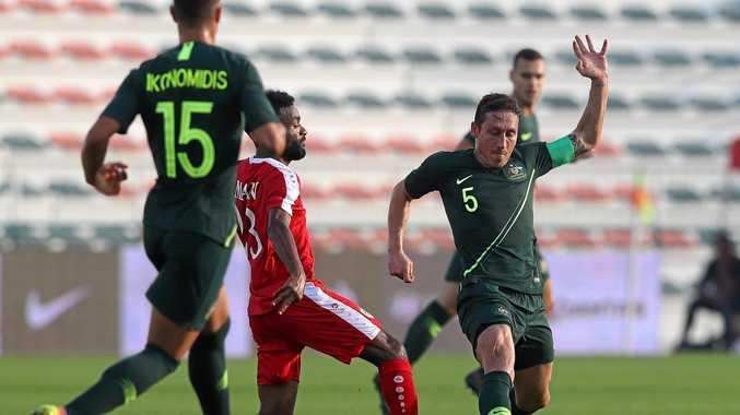 Socceroos skipper Mark Milligan takes it up to Oman in last Sunday's friendly at Maktoum Bin Rashid Al Maktoum Stadium, Dubai. Picture: Francois Nel/Getty Images