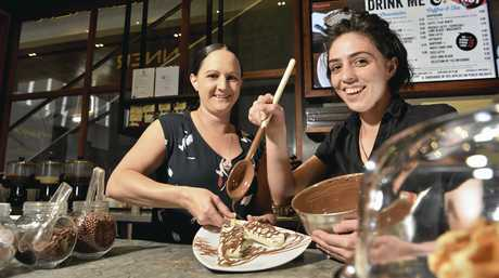 CHOCAHOLICS REJOICE: Max Brenner Queensland area manager Tara Le Pierres (left) and Toowoomba branch manager Megan Hogan in the re-opened chocolate bar in Grand Central.