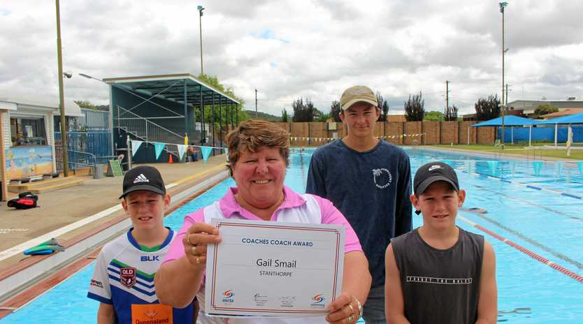 GOOD SPORT: Gail Smail (centre) with swim students Isaac Kay, Ben Armbruster and William Kay.