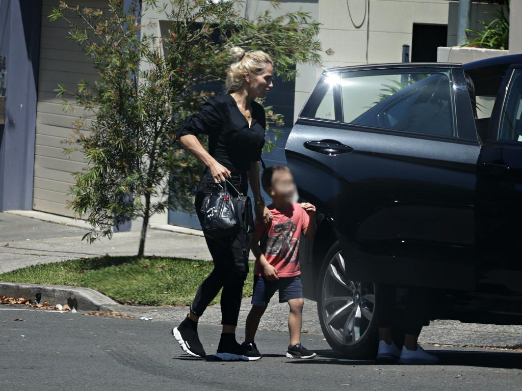 Viktoria Karida and her son outside John Macris's parents home in Mosman. Photographer: Adam Yip