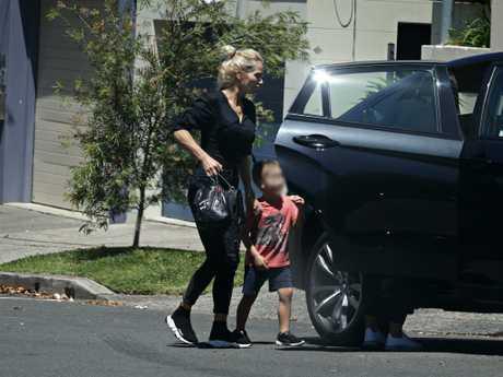 Viktoria Karida and her son outside John Macris's parents home in Mosman. Photographer: Adam Yip