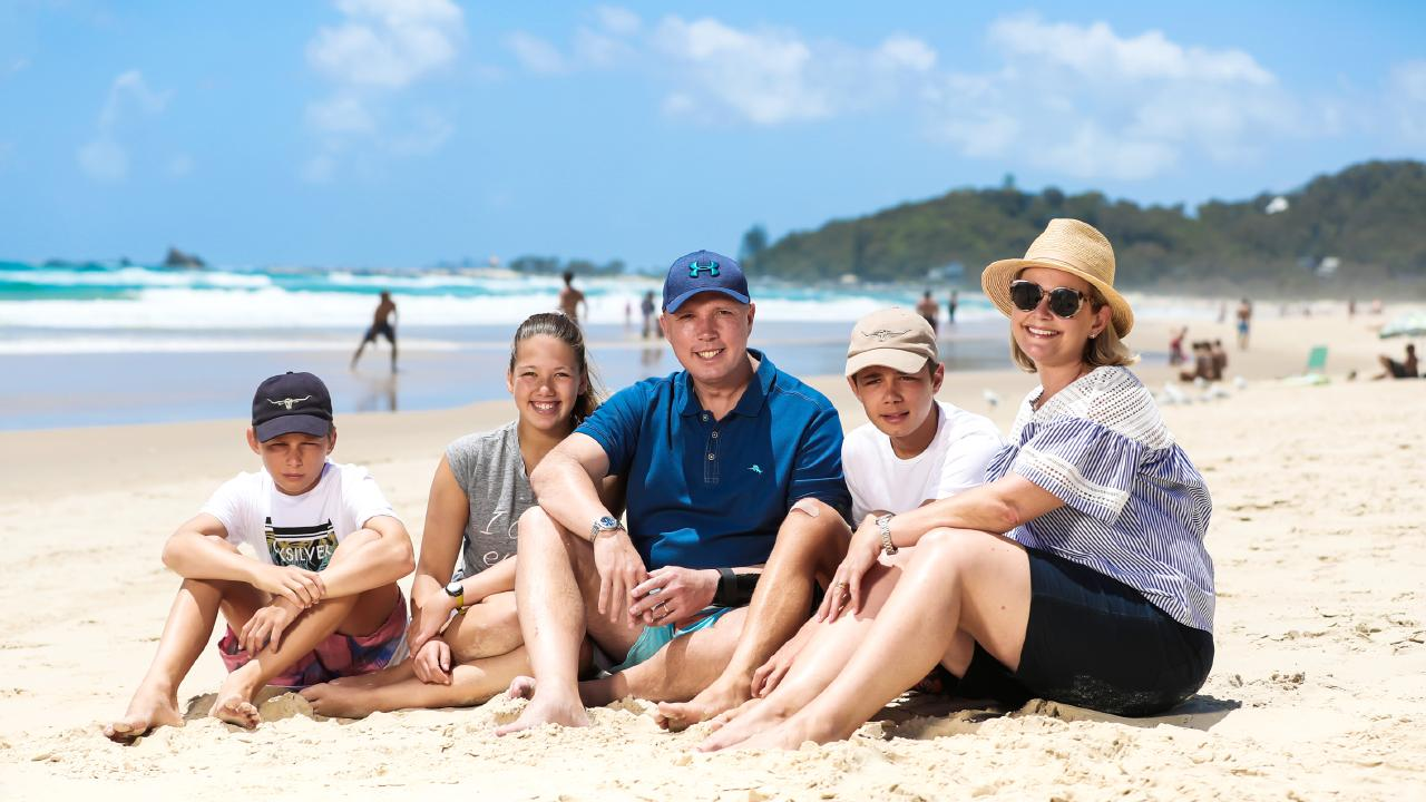 Peter Dutton and wife Kirilly with their two sons Harry, 14, Tom, 13 and daughter Rebecca taking a break on the Gold Coast. Picture: Nigel Hallett