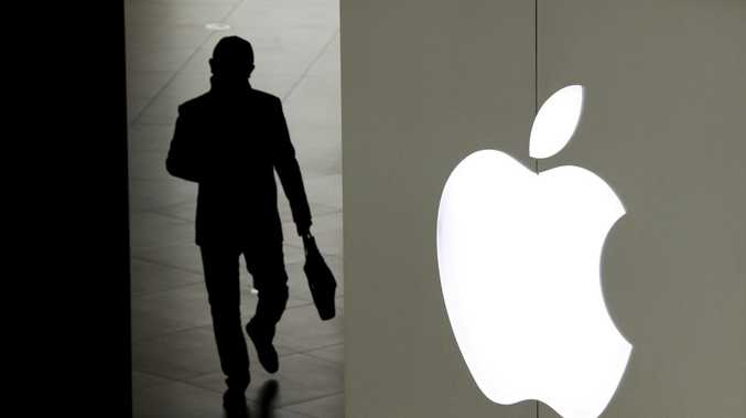 A man leaves an Apple store in Beijing. Picture: AP
