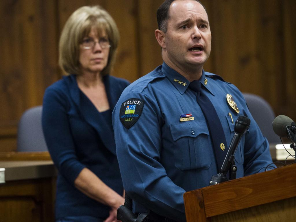 Woodland Park Police Chief Miles De Young answers questions about the disappearance of resident Kelsey Berreth, while her mother, Cheryl Berreth, stands in the background. Picture: AP