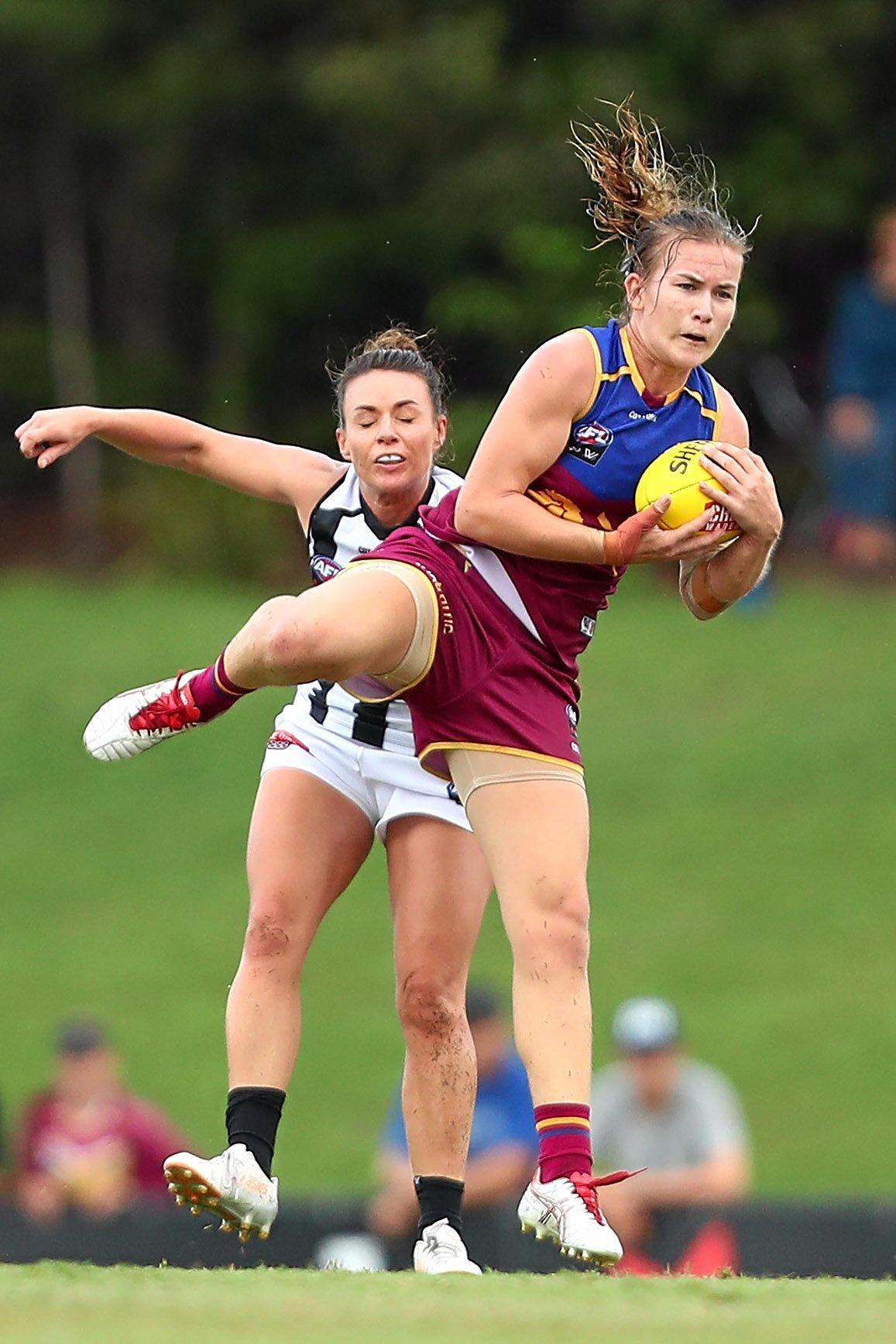 TAKING A MARK: Shannon Campbell of the Lions during an AFLW match against the Magpies at Moreton Bay last season.