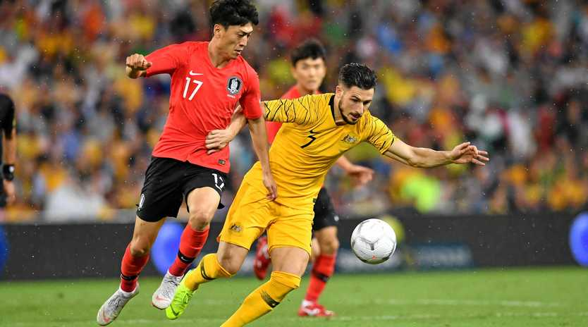 Lee Chungyong of Korea Republic takes on the Socceroos' Mathew Leckie during an international friendly in Brisbane on November 17 last year. Picture: Darren England/AAP