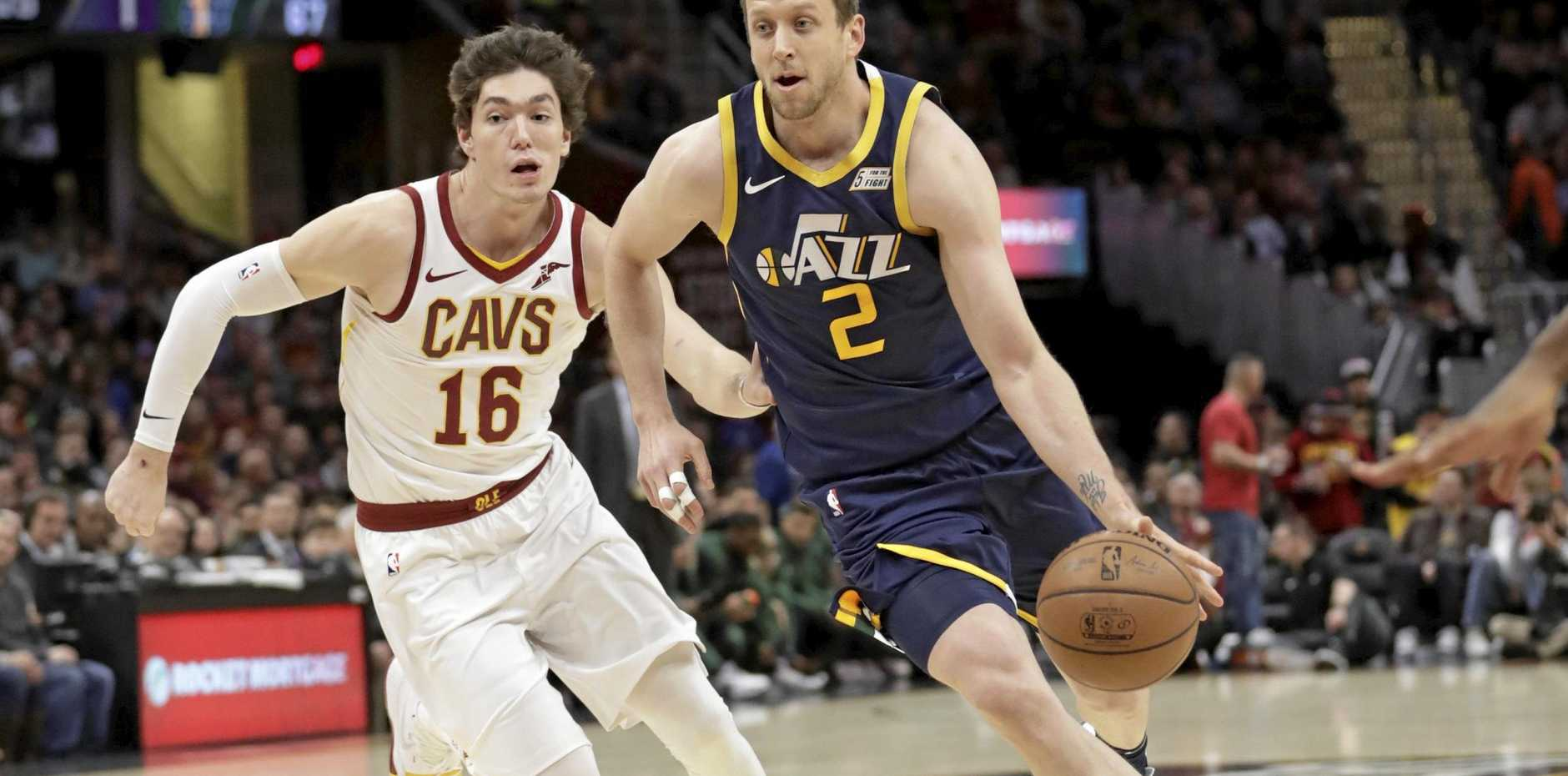 The Jazz's Joe Ingles drives past the Cleveland Cavaliers' Cedi Osman in the first half. Picture: Tony Dejak/AP