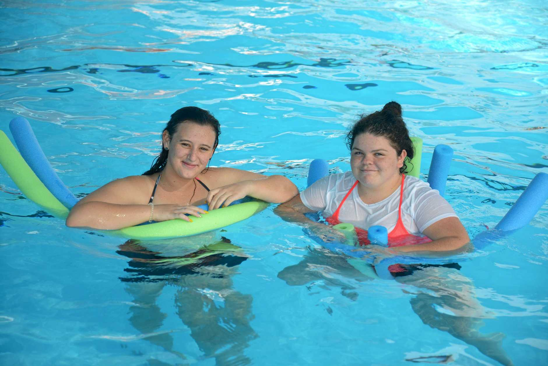 Maddi Fitzgerald and Bethany Chisnell cool down at the Allora swimming pool at the weekend.