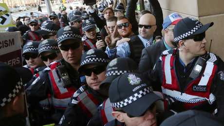 A court appearance by Blair Cottrell and Neil Erikson required an enormous police presence due to far-left protests outside. Picture: David Crosling