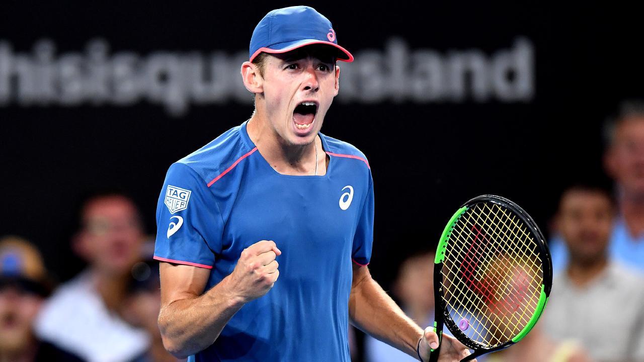 Alex de Minaur has won his first match at the Sydney International.