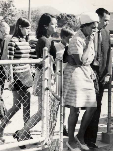 A photograph of the Mackay family at the funeral of sisters Judith (7) & Susan Mackay (5) on September 2, 1970.