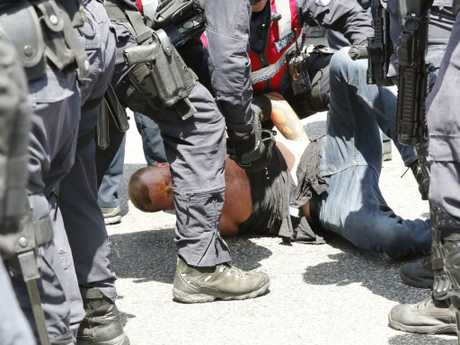 Police clash with a man at St Kilda Beach on Saturday. Picture: Matrixnews.com.au