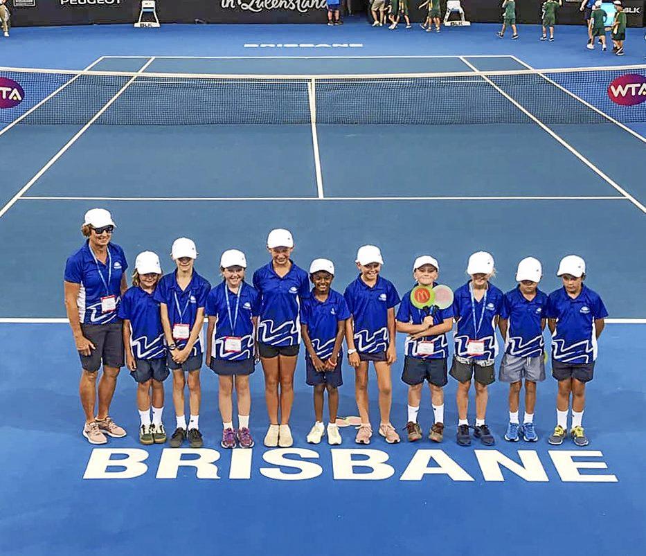 SERVING IT UP: Coach Angie Draheim with Levi Fraser, Ryan Sevensen, Phoenix Arpas, Sunni Rassmussen, Josie Peters, Drew Poustie, Asher Mergerd, Marley Lowcock, Hannah Lawrence and Parem Shah at centre court of the Queensland Tennis Centre.