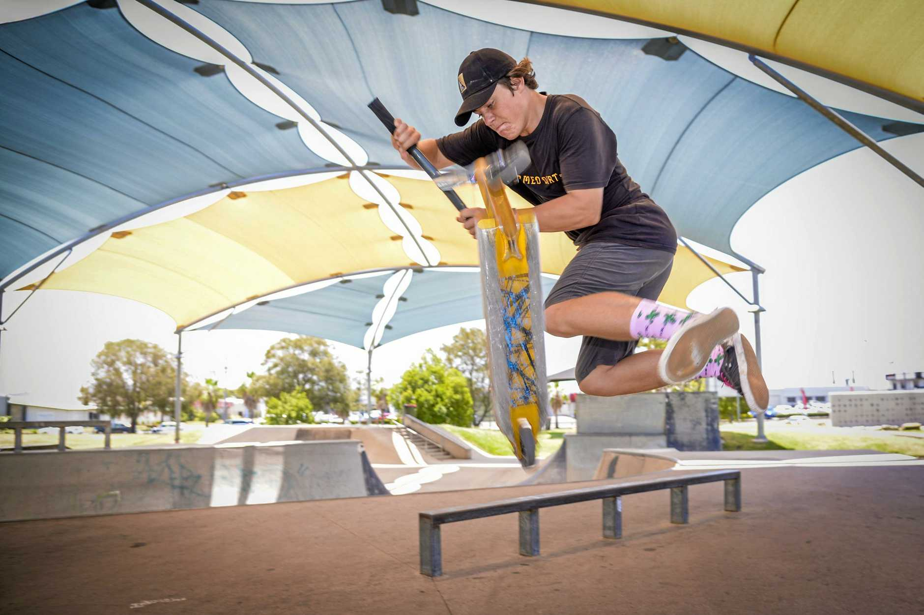 CJ Mason performs a scooter trick at the Gladstone Skate Park this weekend.