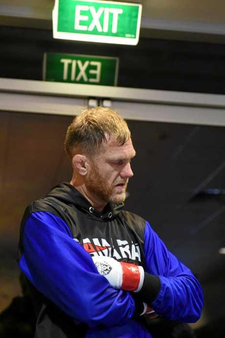 Greg Atzori prepares backstage ahead of his final MMA bout at Eternal MMA 39 At Southport Sharks on Saturday, November 24.