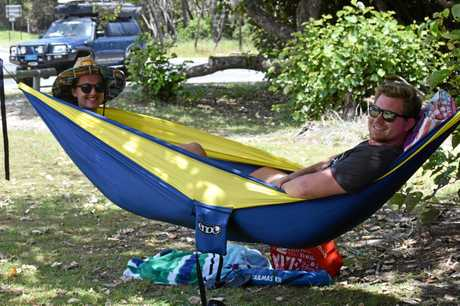 MADE IN THE SHADE: Emily Hagan and Luke Drummond from Hervey Bay made themselves comfortable at Rainbow Beach..