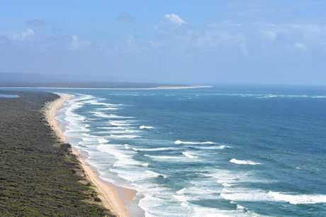 SURFSIDE: Inskip Point and the beach heading towards Fraser Island (top).