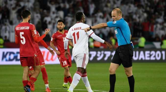 The referee points to the spot to give UAE a lifeline in the Asian Cup opener.