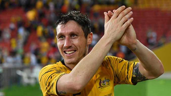 Mark Milligan is expecting a stern test from Syria.
