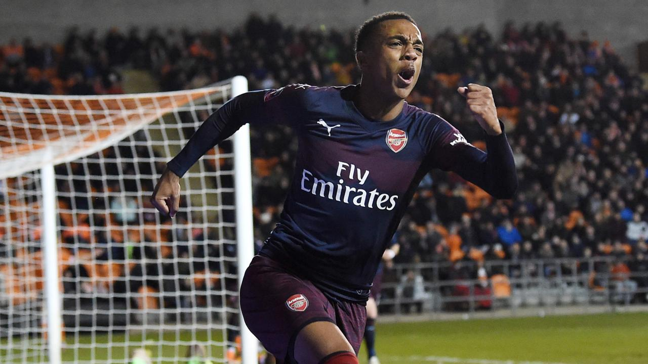 Joe Willock celebrates after becoming Arsenal's youngest FA Cup scorer.