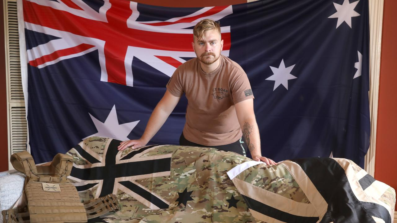 Veteran Matt Williams, who is fighting cancer, had an Australian flag stolen while fundraising for Cure Brain Cancer — but has since received replacement flags from on-duty soldiers who heard his story on social media. Picture: AAP / Dean Martin