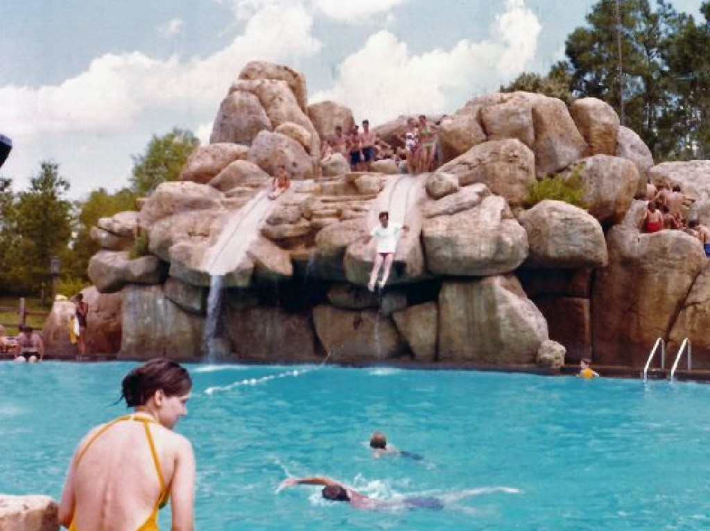 People going down the famous water slide at the peak of the park's popularity.